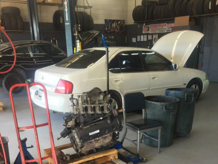 auto maintenance on car inside shop